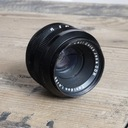 Carl Zeiss Jena Tevidon 25mm f/1.4 - kryje m4/3